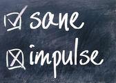 Sane and impulse choice sign on blackboard — Stock Photo