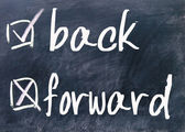 Back and forward choice on blackboard — Stock Photo