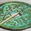 Acupuncture needle on antique chinese coin — Stock Photo #56413559
