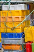Empty boxes for fish on a trawler — Stock Photo