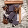 Chocolate crumbs, star anise and cinnamon sticks. — Stock Photo #57925649