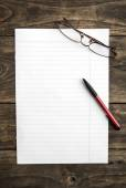 Blank note paper with pen on table — Stock Photo