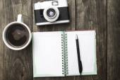 Vintage camera, diary with pan and cup pf coffee — Stock Photo