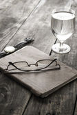 Writing concept: glasses, notes, glass of water — Стоковое фото
