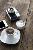 Cup of coffee with sugar on wooden table — Stock Photo