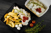 Delicious portion of rustic potatoes fillet with aromatic herbs — Stock Photo