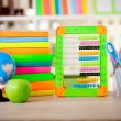 Abacus,globe, books and pencils on table,back to school concept — Stock Photo #53059687