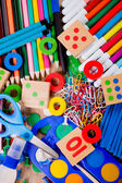 Background of a colorful assortment of school supplies — Stock Photo
