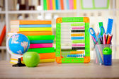 abacus,globe, books and pencils on table,back to school concept — Stock Photo