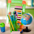 Abacus,globe, books and pencils on table,back to school concept — Stock Photo #53060669