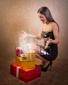 Happy teenage girl with magical Christmas present box  — Stock Photo