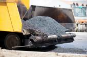 Tracked paver laying fresh asphalt pavement  during road constru — Stock Photo