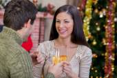Couple holding glasses with champagne and celebrate Christmas ni — Stok fotoğraf