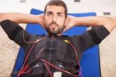 Man working on electro muscular stimulation machine — ストック写真