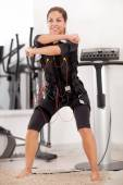 fit woman exercise on electro muscular machine  — Foto de Stock