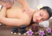 Beautiful woman having a wellness back massage at spa salon  — Stock Photo