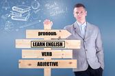 Teacher holding a wooden sign learn English — Photo