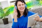 Young modern girl  with electronic tablet  listening music — Stockfoto