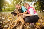 Children in the park with a German Shepherd — Fotografia Stock