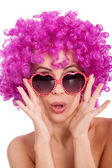 Sexy woman with fancy glasess and pink wig — Stock Photo