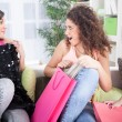 Three excited young girls after shopping at home — Stock Photo #59187889
