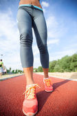 Runner feet running on road,woman fitness and welness concept.  — Stock Photo
