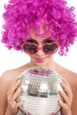 Beautiful young girl with pink wig holding  disco ball,isolated — Stock Photo