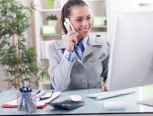 Business concept - businesswoman talking on the phone in office — Stock Photo