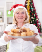 Happy granny  with cookies in Christmas night,Xmas concept — Stockfoto