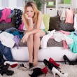 Nothing to wear concept, young woman deciding what to put on — Stock Photo #62456833