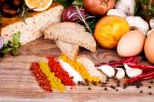 Cheese, eggs, fresh herbs and spices — Stock Photo