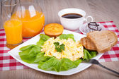 Scrambled Eggs with with orange juice and toasted bread — Stock Photo