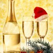 Glasses of champagne and decoration with natural fir branch — Stock Photo #62910361
