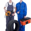 Two confident mechanic holding tire over white background — Stock Photo #63585213