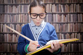 Young scientist, hustler with glasses in the library, with a hug — Stock Photo