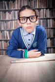 Funny young scientist, hustler with glasses in a library — Stock Photo