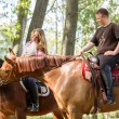 A couple on a horse ride — Stock Photo #72367375