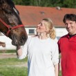 Loving couple with horses — Stock Photo #72369259