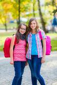 Teenage schoolgirls with schoolbag — Stock Photo