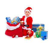 Little Santa Claus boy with presents — Stock Photo