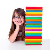 Girl next to book column — Stock Photo