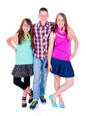 Teen boy standing with two girlfriends — Stock Photo