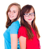 Two teen girls standing back-to-back — Stock Photo