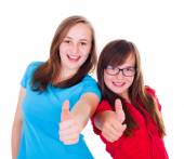 Teen girls showing thumbs up — Stock Photo