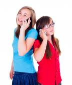 Girls talking on their mobile phones — Stock Photo