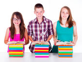 Students with colorful books — Stock Photo