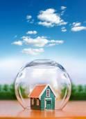 Insured house under glass sphere — Stock Photo