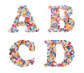 Capital characters made of colorful sprinkles — Stock Photo