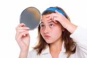 Girl examine her pimples in the mirror — Stock Photo