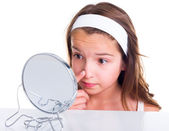 Girl searching for pimples — Stock Photo